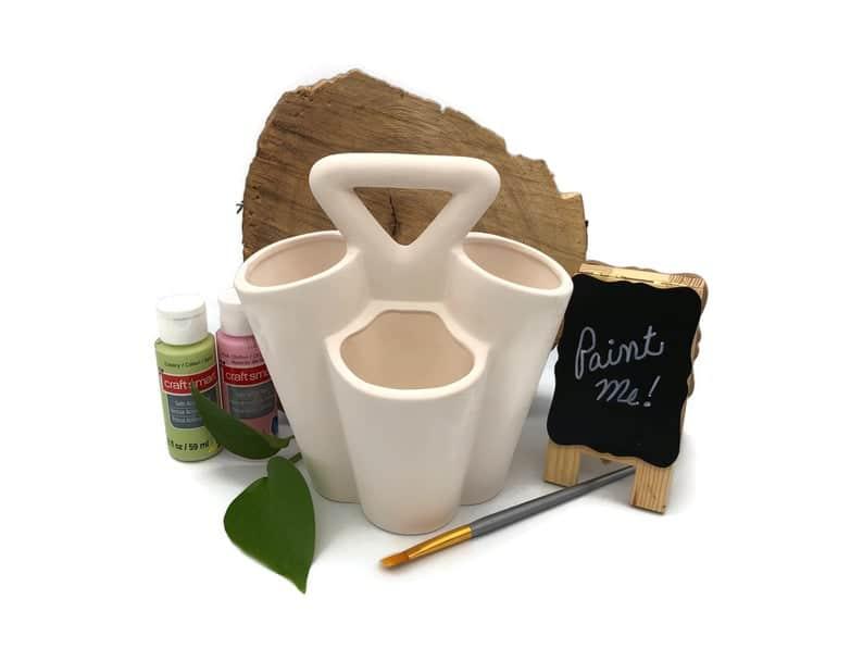 Paint brush storage: personalised paint holder